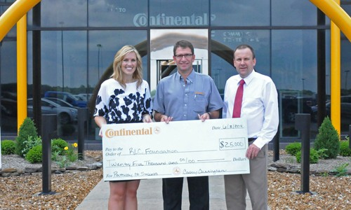 "Benny Harmse, Continental Tire the Americas (CTA) Mt. Vernon Plant Manager, CENTER, donates $25,000 to the Rend Lake College Foundation for the ""Pathway to Success"" campaign. CTA is the lead donor of the campaign, which will update the Administration Building and walkway on the Ina campus as well as provide scholarships to students in need. Pictured with Harmse is Shawna Manion, RLC Foundation CEO, LEFT, and Terry Wilkerson, RLC President, RIGHT. Click on the image for a larger view. (ReAnne Palmer / RLC Public Information)"
