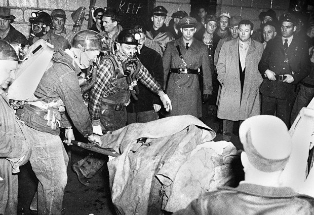 Rescue workers are pictured with one of the 119 miners killed on Dec. 21, 1951 in the Orient 2 explosion.