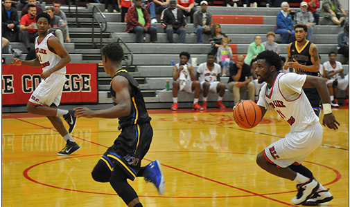 Cory Thomas, RIGHT, sprints down the court to score during the first half of the RLC game against ICC. Thomas scored 19 points against the Cougars. Also pictured is Anton Ivy, LEFT. Click on the image for a larger view. (ReAnne Palmer / RLC Public Information)