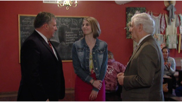Rachel Rabe (center) with Founder and Guild CEO Tim Morthland (left) and President Glenn Poshard (Right) (WSIL Photo)
