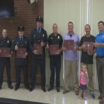 Good Samaritan, police officers honored for saving woman from sinking car